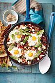 Fried eggs with chard, tomatoes and dukkah
