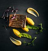 Risotto, fried fish and mangetout