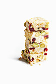 White chocolate and passion fruit bars with puffed rice, cranberries, and pistachios