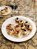 Various snacks (puff pastry with roast beef, potatoes with sour cream and caviar)