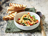 Couscous with oven-baked Moroccan vegetables served with toasted baguette