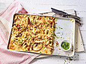 Ham spätzle (soft egg noodles from Swabia) on a baking tray