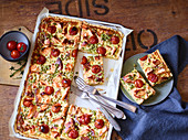 Tray bake salmon tart with tomatoes