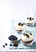 Lemon cheesecake with blueberries in glasses