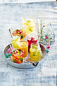 Five fruity mocktails on a tray