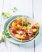 Skewer with marinated apples and prosciutto