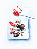 Pudding with chocolate sauce and berries