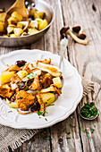 Fried potatoes with mushrooms and spring onions