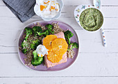 Orange salmon with broccoli and rice for mum and mashed for baby