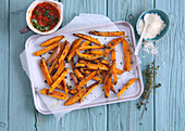 Sweet potato chips with tomato sauce