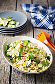 Farfalle with zucchini, chili and peppermint leaves