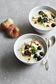 Cold millet soup with blueberries and peaches