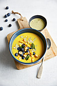 Golden mango milk with blueberries and turmeric