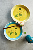 Cream of yellow courgette curry soup with chestnuts