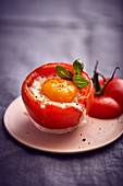 A tomato filled with an egg and mozzarella