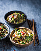 Quinoa with brown mushrooms, spring onions and sesame