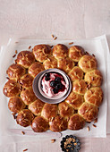 Orange and pine nut brioche wreath with amarena quark