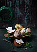 Fresh porcini mushrooms in a wooden dish
