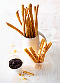 Grissini and cheese sticks with an olive dip