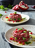 Oriental beef tartare with pomegranate seeds