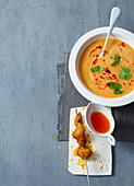 Lentil soup with a curry and chicken skewer