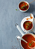 Tomato soup with herb and bacon olives