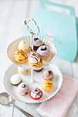Various mini cupcakes on a cake stand