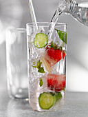 Water with cucumber and strawberries