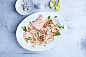 Spelt penne with sauerkraut and salmon