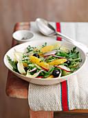 Bitter salad wit oranges, radishes and olives