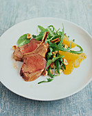 Lamb chops with arugula and orange salad