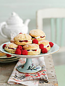Lemon scones with raspberries, served with tea