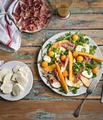 Mozzarella salad with melon and prosciutto