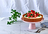 No-bake cheesecake flavoured with rose and lemon and topped with fresh strawberries