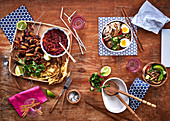 Mexican chicken skewers and oriental noodle soup