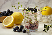 A glass of blueberry lemonade with thyme