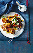 Roasted Cajun chicken with corn and capsicum sweet potatoes