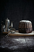 A vegan chocolate Bundt cake with icing sugar