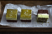 Vegan chocolate cake with tonka bean cream, matche cream and matcha jelly