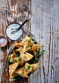 Stuffed samosas with a mint yoghurt dip