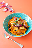 Carrot spaghetti with curried chicken, cranberries and mint