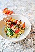 Parsnip noodles with spinach and lamb kebabs