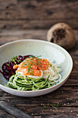 A beetroot, radish and cucumber noodle salad with smoked salmon