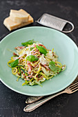Courgette and pointed cabbage with bacon, basil and Parmesan