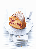A slice of apple and cinnamon cake with cherries