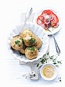 Cheese dumplings with parsley and a tomato salad
