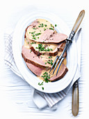 Roast veal with a creamy sauce garnished with chives