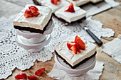 Brownies with cheesecake cream and strawberries