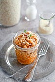 Risotto with ragout served in a glass