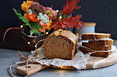 Autumnal carrot cake in a loaf tin, sliced